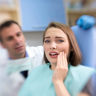 A patient with toothache at General Dentistry in Mankato