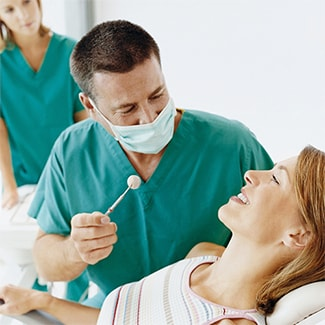 Doctor applying fluoride treatment to a patient at General Dentistry in Mankato