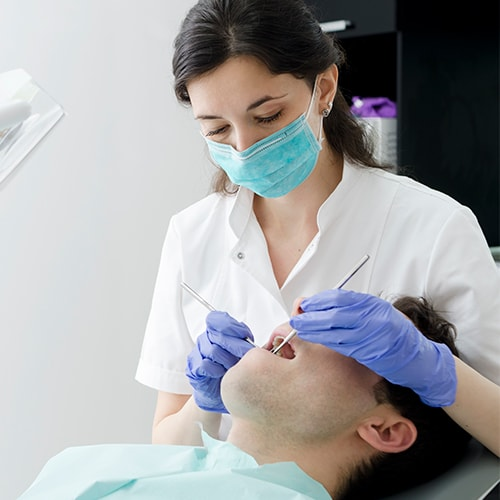 A dentist treating a patient at Mankato Cosmetic Dentistry