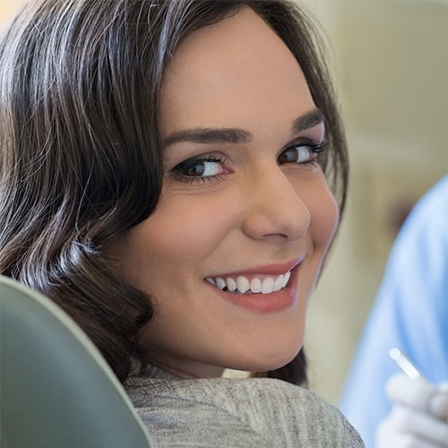 Woman smiling thanks to Mankato Cosmetic Dentistry
